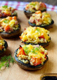 Stuffed mushrooms. On the board Royalty Free Stock Photography
