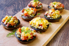 Stuffed mushrooms. On the board Royalty Free Stock Images