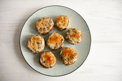 Stuffed mushrooms. With cheese and herbs Royalty Free Stock Photography
