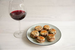 Stuffed mushrooms. With cheese and herbs Stock Photos