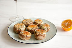 Stuffed mushrooms. With cheese and herbs Royalty Free Stock Image