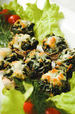 Stuffed mushrooms, stuffed with spinach. Garlic and cheese Spinach and cheese mushrooms broccoli cheese with tomato in salad leaves and dill. tasty snack royalty free stock photo