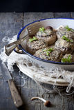 Stuffed mushrooms on vintage enamelled tin on rustic wooden table Royalty Free Stock Images