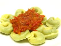 Stuffed noodles with tomato sauce Stock Photography
