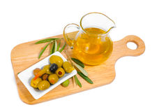The stuffed olives, branches and olive oil Stock Photos