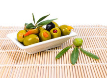 Stuffed olives  with olive branch and leaves Royalty Free Stock Photography
