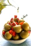 Stuffed olives and olive oil Stock Photography