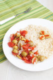 Stuffed olives and tomato salad with couscous Stock Photography