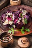 Stuffed onions in Georgian. Onions stuffed with bacon and spices.Turkish and Georgian cuisine royalty free stock photos
