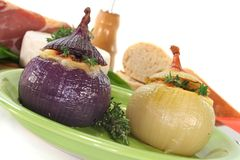 Stuffed onions with goat cheese Stock Photos