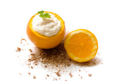 Stuffed orange. Sweet and fresh summer dessert. An orange filled with quark stock images