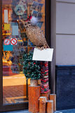 Stuffed owl figure at the entrance to a european shopping mall c. Enter at Christmas time. Riga, Latvia Royalty Free Stock Images