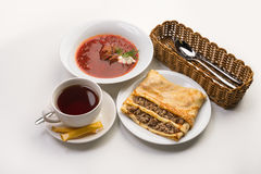 Stuffed pancake and borsch with sour cream Stock Photo