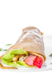 Stuffed pancake with vegetables and meat Stock Image