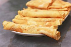 Stuffed pancakes. Pancakes with cheese , chocolate and jam stock images