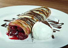 Stuffed pancakes with with cherries Royalty Free Stock Photo