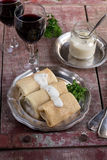 Stuffed pancakes crepes with meat and bechamel Stock Images