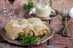 Stuffed pancakes crepes with meat and bechamel Stock Photo