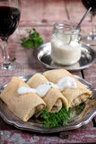Stuffed pancakes crepes with meat and bechamel Stock Image