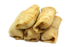 Stuffed pancakes with filling. On a white background stock photos