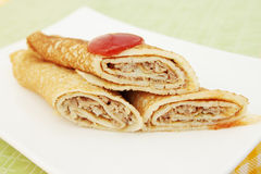 Stuffed pancakes. Thin pancakes stuffed with minced pork salad royalty free stock images