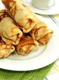 Stuffed pancakes on white plate Stock Image