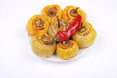 Stuffed paprika and pepper on a plate Stock Photography