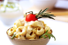 Stuffed pasta and cream sauce Royalty Free Stock Photos