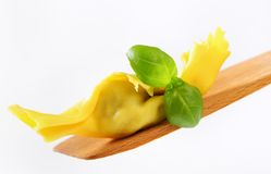 Stuffed pasta on wooden spatula Stock Photos