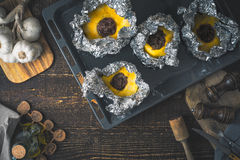 Stuffed pattypan on the  backing sheet on the wooden table Stock Photo