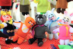 Stuffed people and animal toys at the fair Stock Images