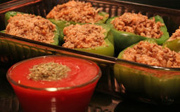 Stuffed Pepper preparation. Stuffed pepper with meat & rice in casserole dish being prepared for dinner Stock Photo