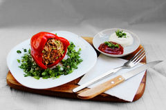 Stuffed pepper on a white plate with cut parsley Royalty Free Stock Image