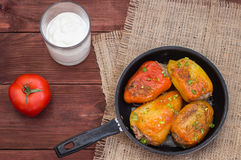 Stuffed pepper. Wooden background. Top view Royalty Free Stock Photo