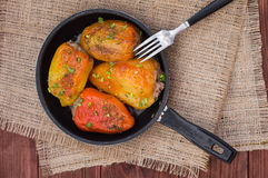 Stuffed pepper. Wooden background. Top view Stock Images