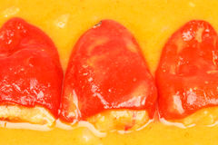 Stuffed peppers. Close-up of red piquillo peppers stuffed with seafood and orange sauce Stock Photos