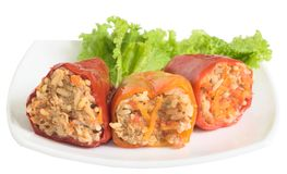 Stuffed peppers. With a lettuce leaf on a white plate Stock Photos