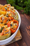 Stuffed peppers in a baking dish Stock Image