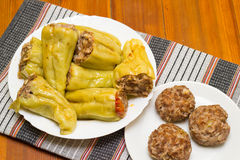 Stuffed peppers. Burgers and steamed stuffed peppers with minced meat and rice Stock Images