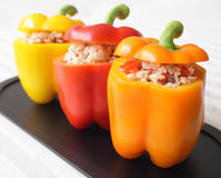 Stuffed Peppers. A colorful trio of bell peppers stuffed with rice, mushrooms, and tomatoes Royalty Free Stock Photos