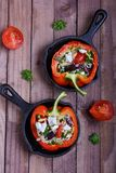 Stuffed peppers. With couscous in pans Royalty Free Stock Images