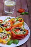 Stuffed peppers. With couscous in plate Stock Photo