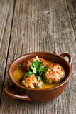 Stuffed peppers in a dish Stock Images