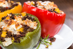 Stuffed Peppers (with Meat, Herbs and Cheese). On wooden background royalty free stock image