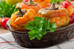 Stuffed peppers minced chicken with carrots with tomato sauce Stock Image