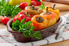 Stuffed peppers minced chicken with carrots with tomato sauce Stock Photos