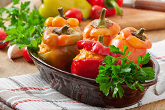 Stuffed peppers minced chicken with carrots with tomato sauce Royalty Free Stock Photography