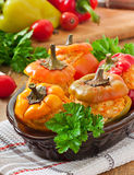 Stuffed peppers minced chicken with carrots with tomato sauce Royalty Free Stock Image