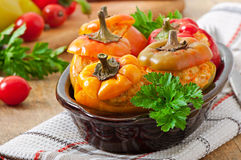 Stuffed peppers minced chicken with carrots with tomato sauce Royalty Free Stock Photos