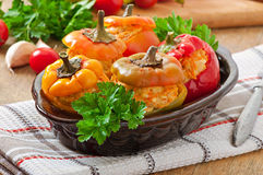 Stuffed peppers minced chicken with carrots with tomato sauce Royalty Free Stock Images